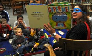 reading interesting storybooks to young readers