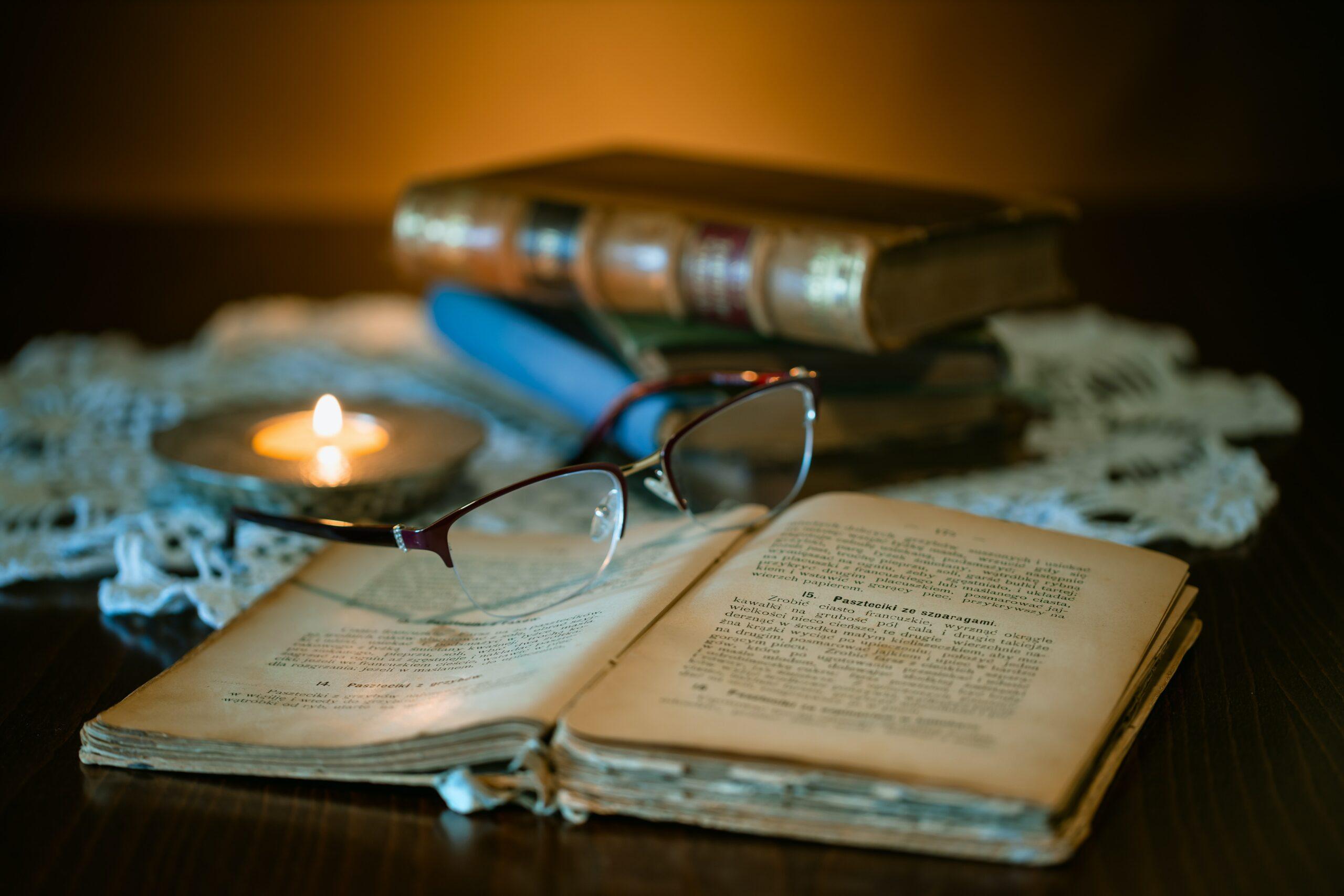 history book and eyeglasses