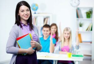 teacher and students in a classroom setting