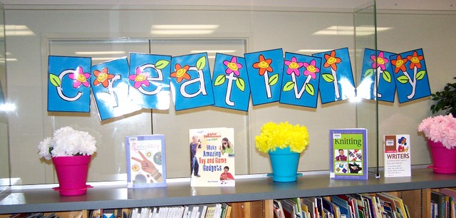 spring bulletin board design: flowers, books, posters