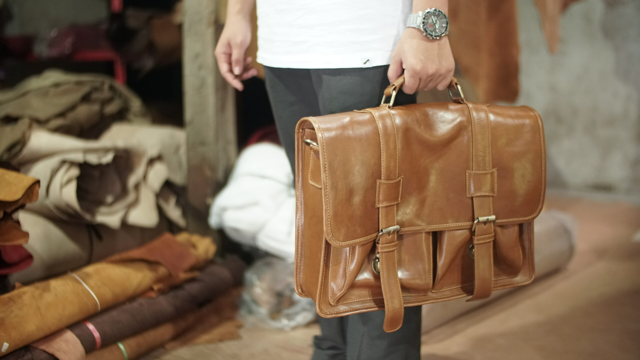holding a leather bag great for teachers