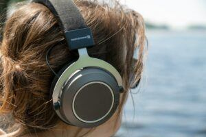 wearing a wireless headphone while looking at the sea