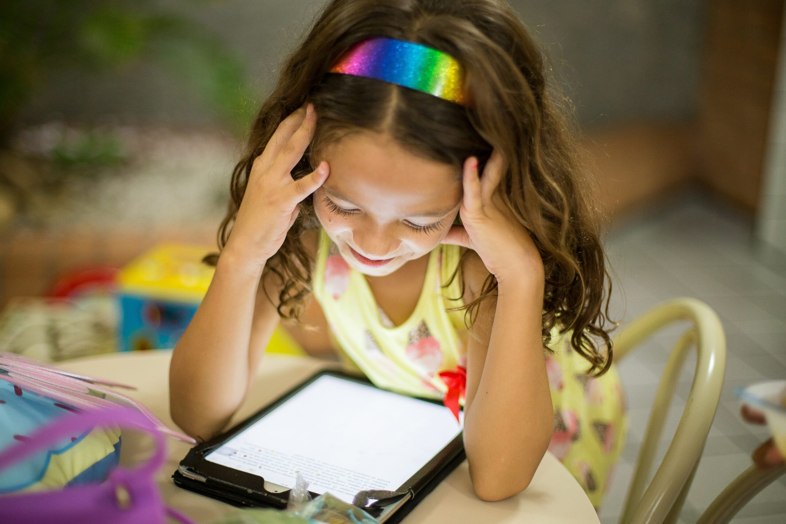 a little girl playing with an app on her iPad