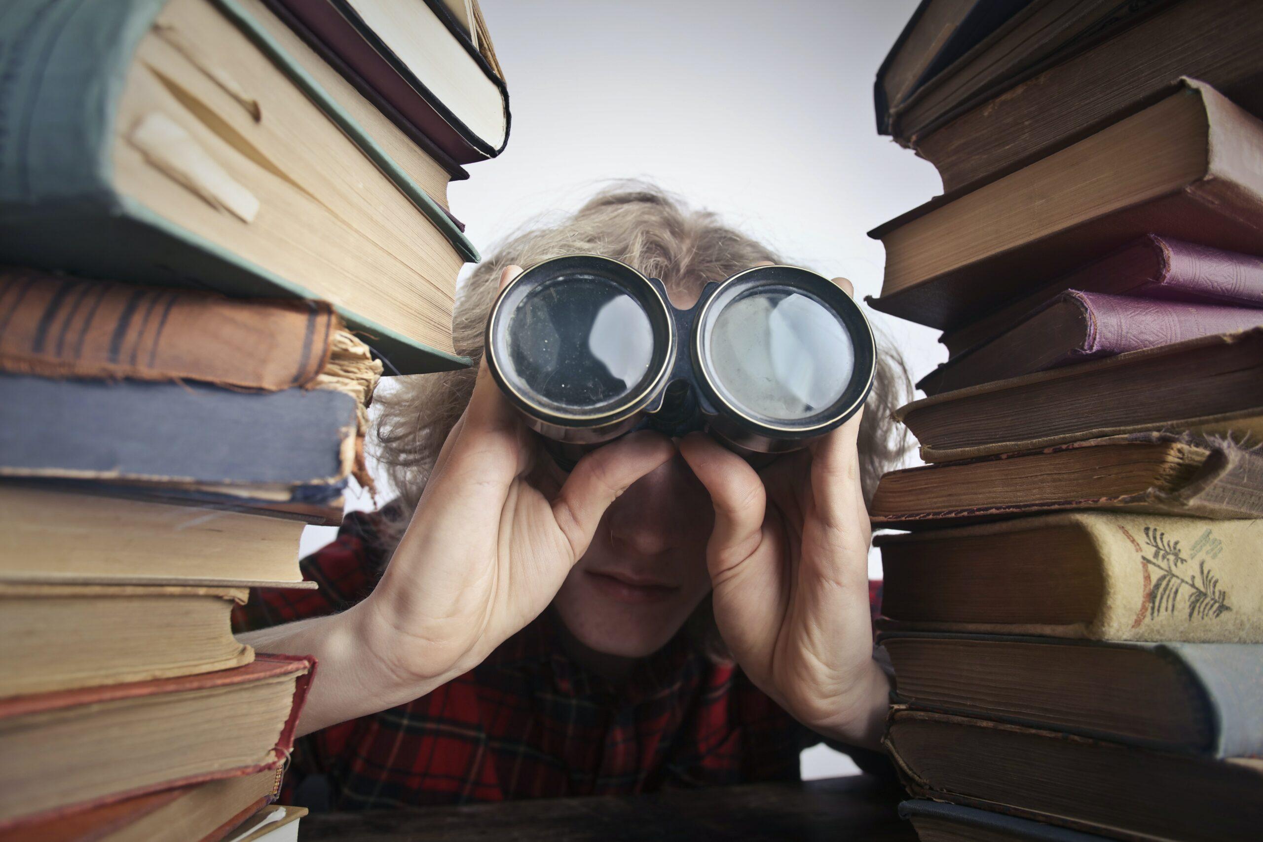 Peeking Through Towers Of Books