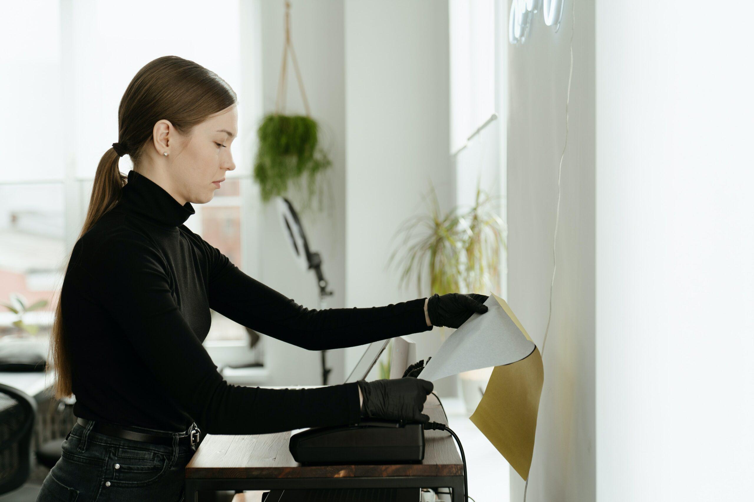 a teacher using a printer