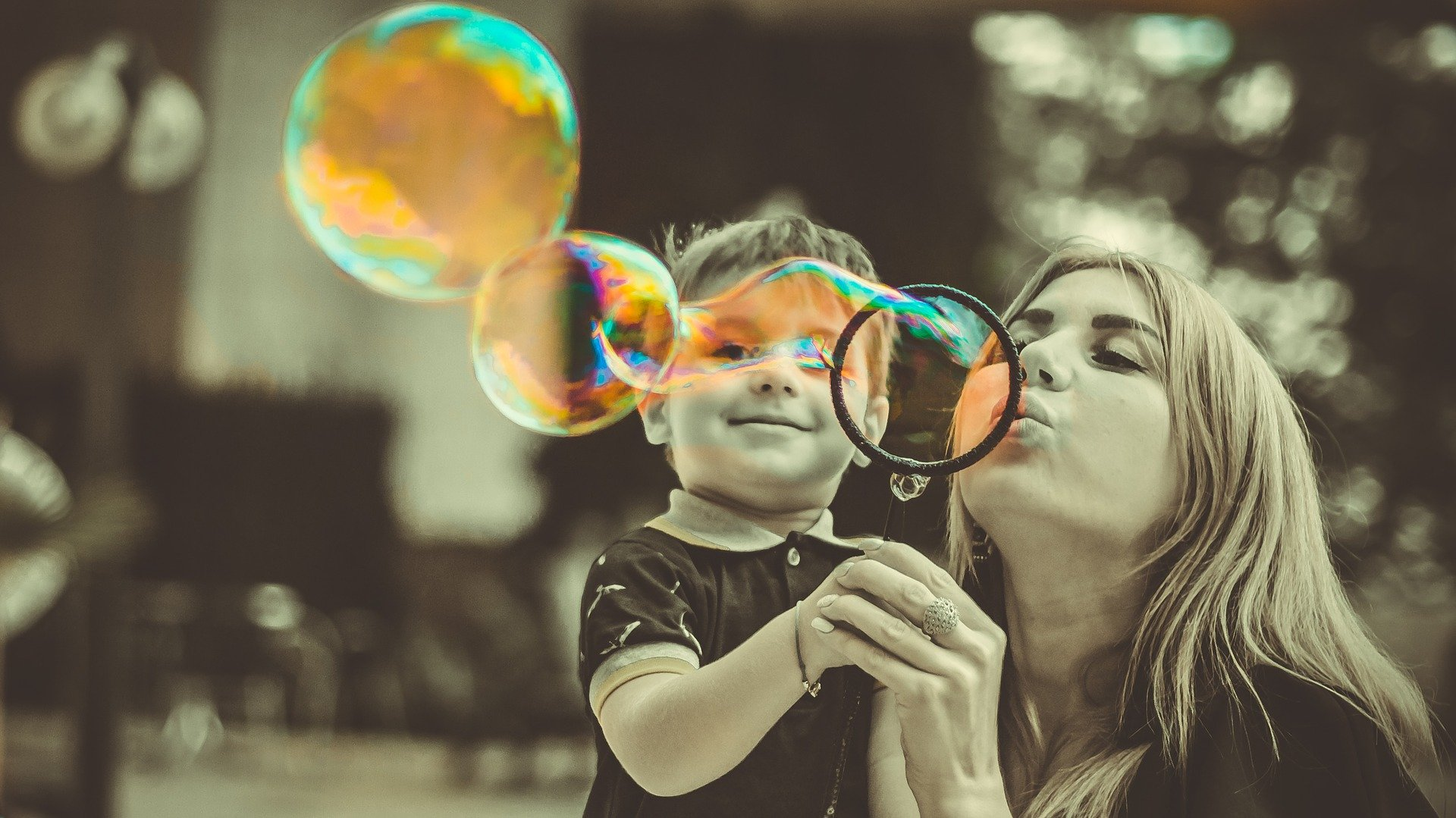 a teacher and her student playing with bubbles