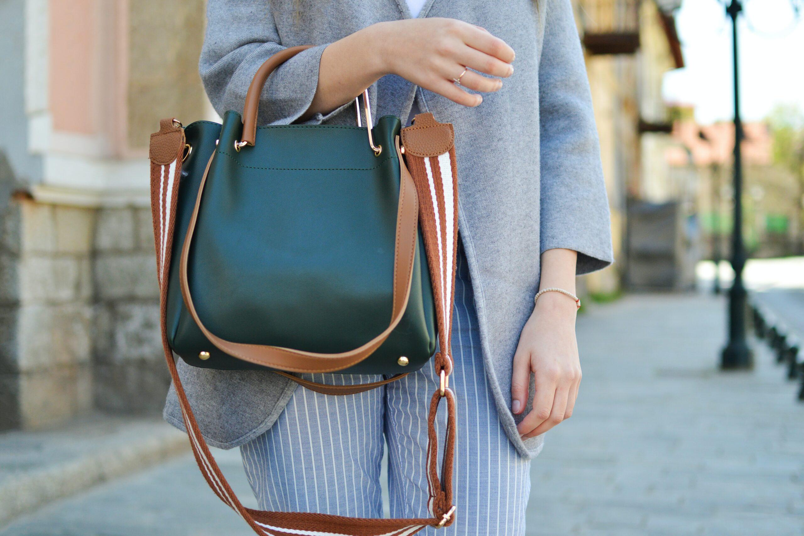 a teacher holding her shoulder bag