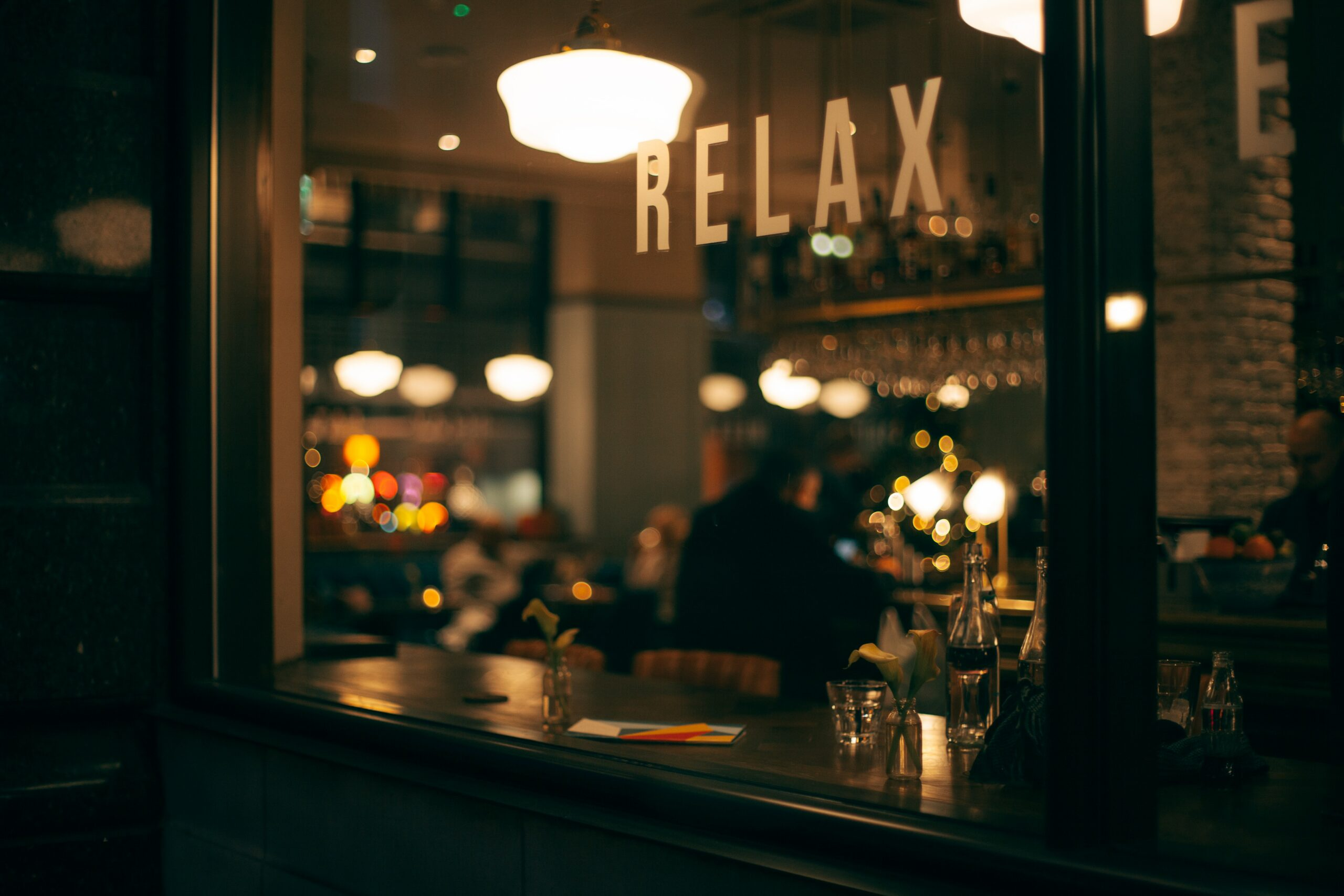 "a café with a ""relax"" sign by the window"