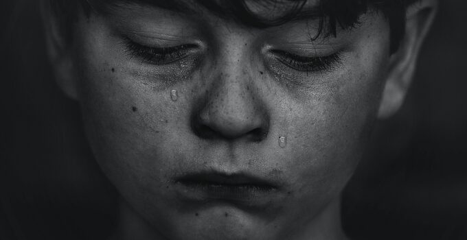 a kid crying because he is being bullied