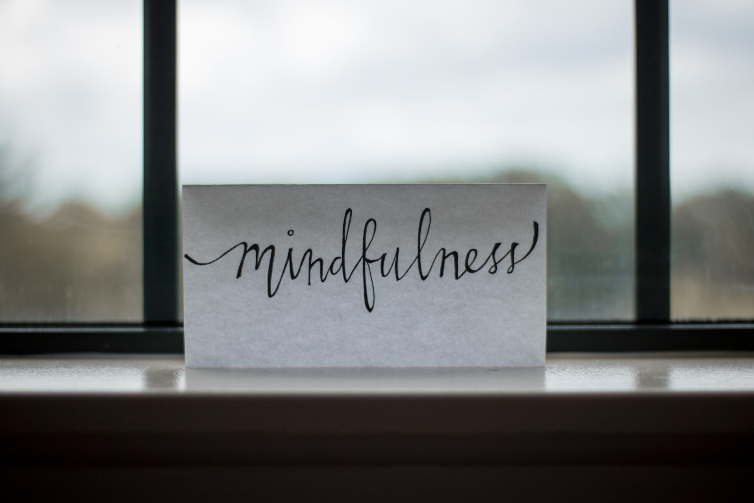 """a note with """"mindfulness"""" written on it"""