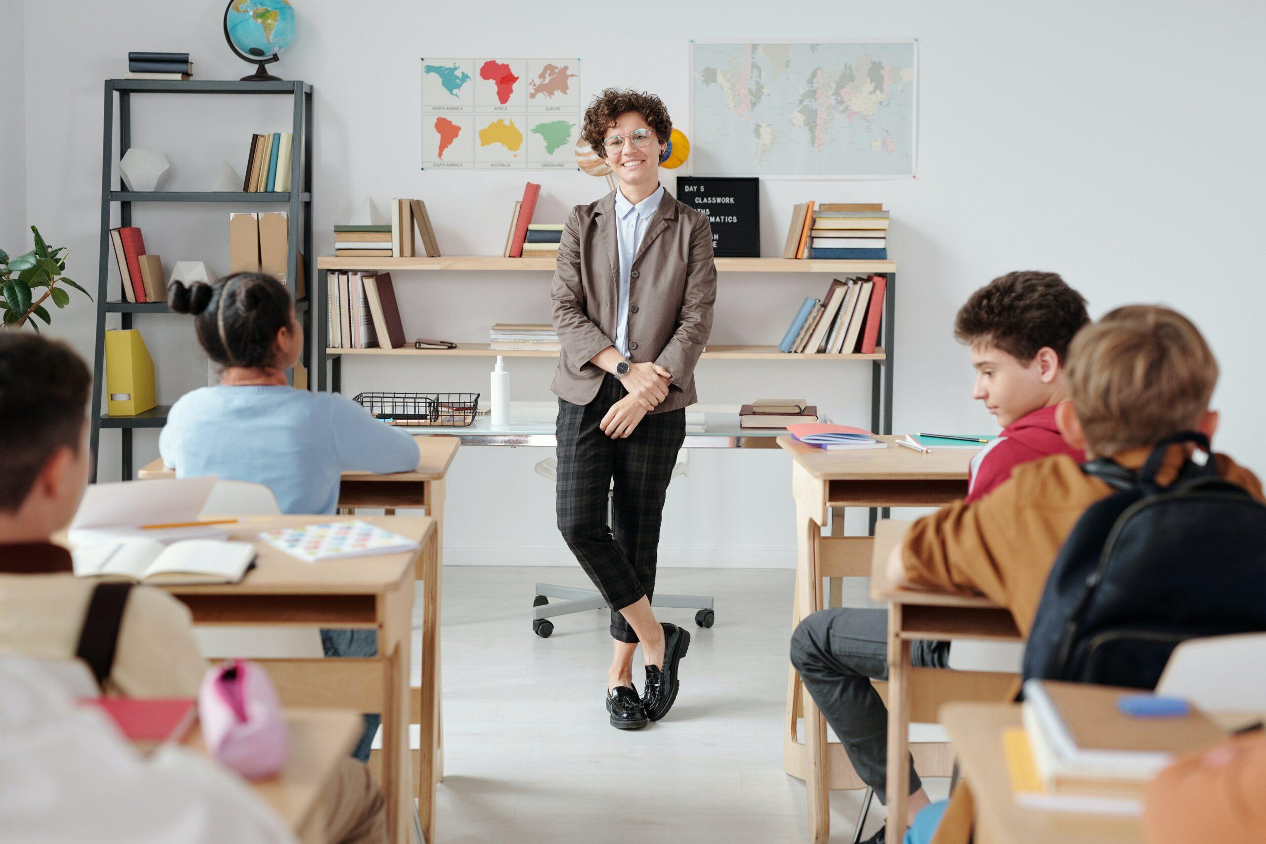 a teacher standing in front of her class