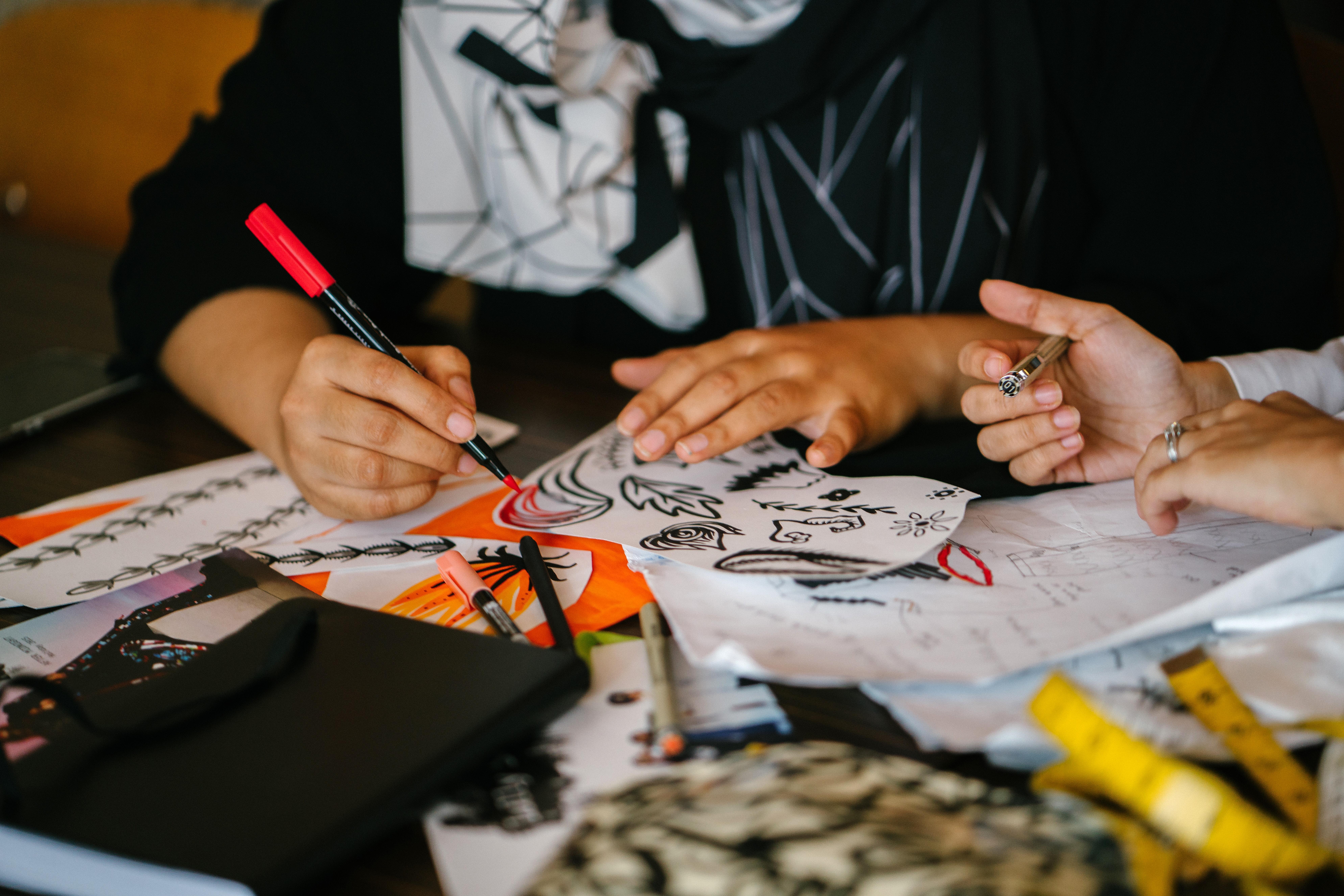 teachers being creative enjoying an adult coloring book