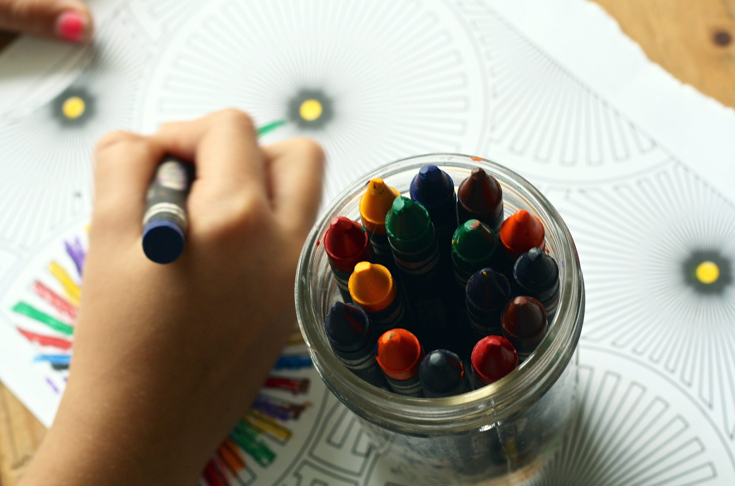 a student coloring a coloring book