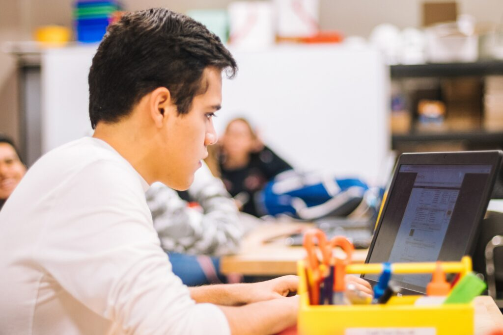student using laptop in the classroom