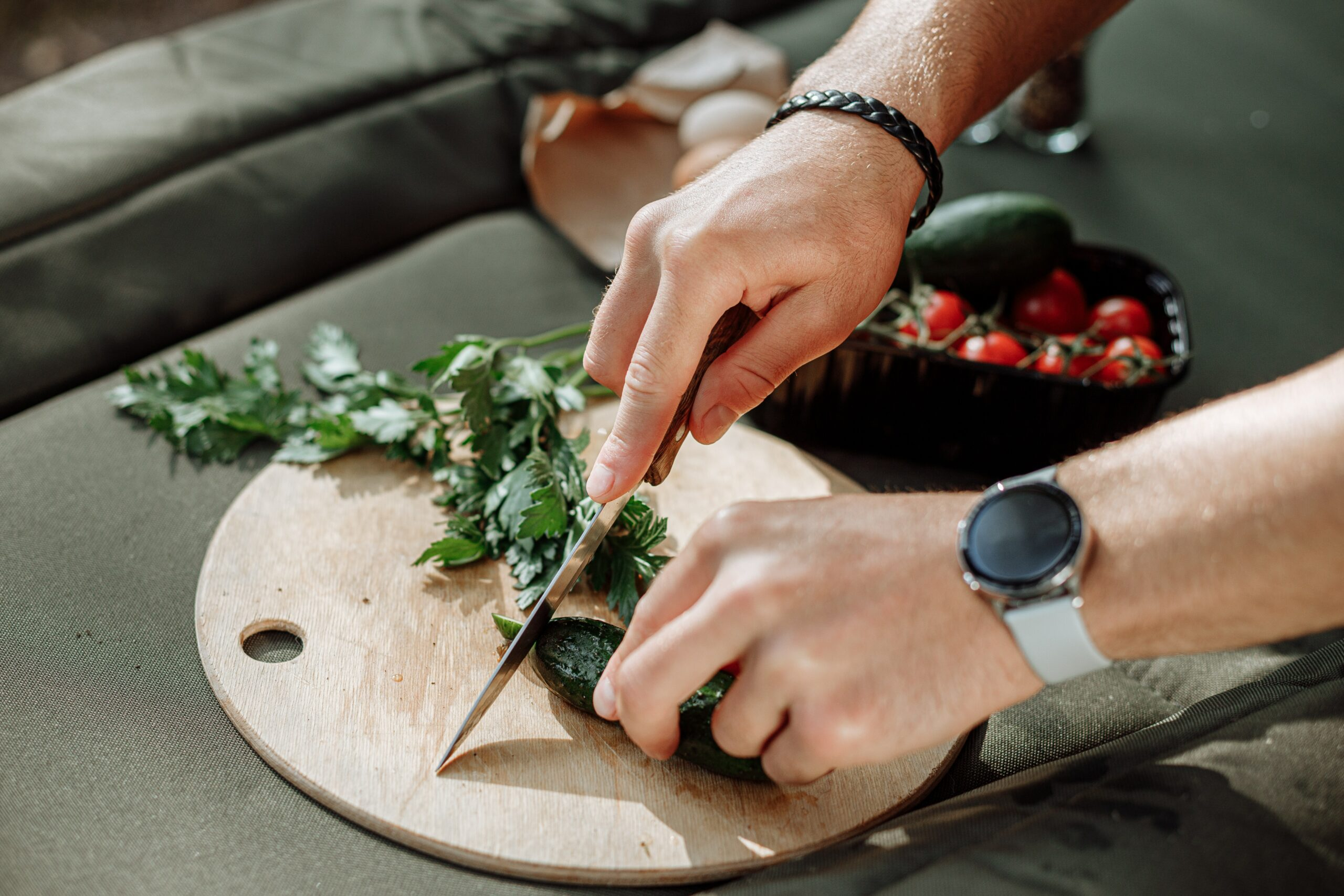 a smartwatch on a man's hand while cooking