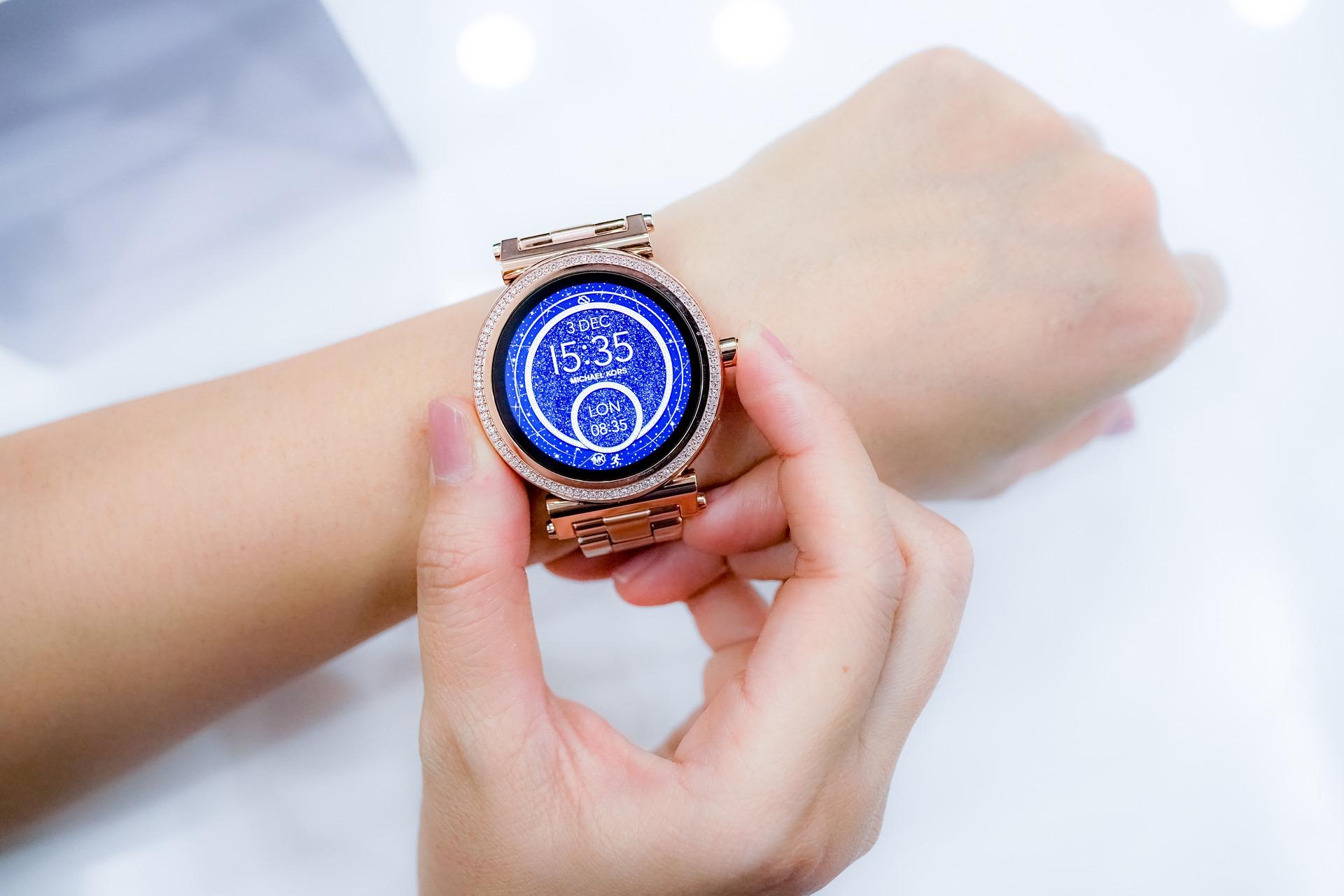 a hybrid smartwatch on a teacher's hand